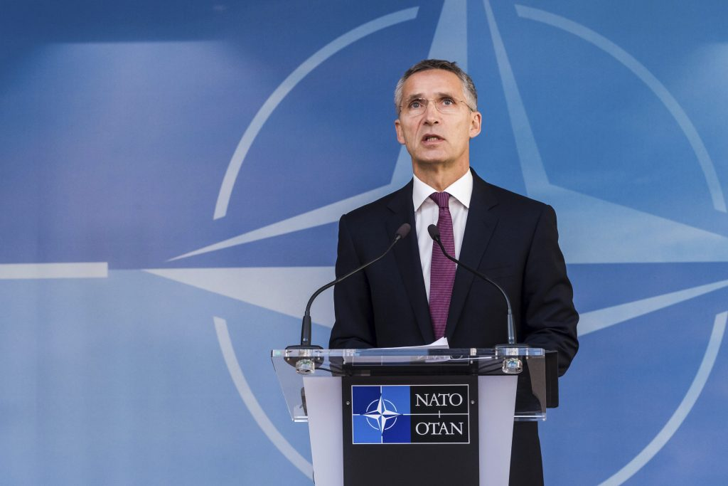 NATO Secretary General Jens Stoltenberg addresses the media at the start of a meeting of the North Atlantic Council Defense Ministers at NATO headquarters in Brussels on Wednesday. (AP Photo/Geert Vanden Wijngaert)