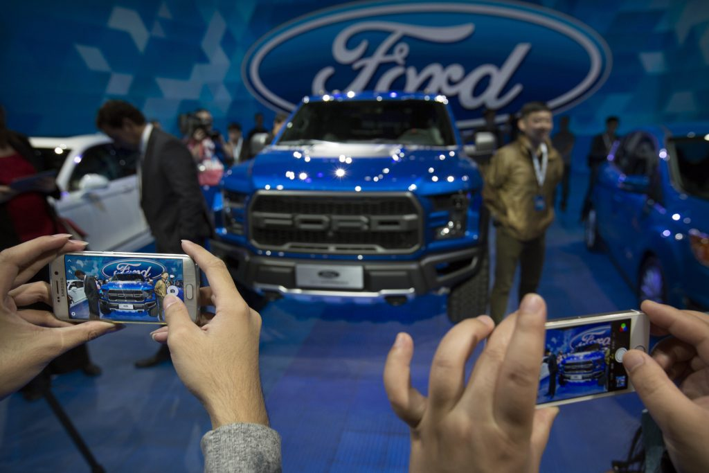 A Ford F-150 Raptor pickup truck at a promotional event for Ford in April, ahead of the biennial Auto China car show in Beijing. (AP Photo/Mark Schiefelbein, File)