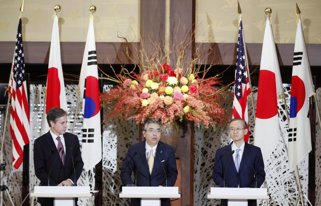 U.S. Deputy Secretary of State Antony Blinken, left, Japanese and South Korean counterparts Shinsuke Sugiyama , center, and Lim Sung-Nam, attend a joint press conference in the Iikura guesthouse in Tokyo, Thursday, Oct. 27, 2016. Senior officials from Japan, the United States and South Korea have agreed to step up pressure on North Korea as they stick to their goal of persuading the communist state to abandon its nuclear weapons. (Kyodo News via AP)