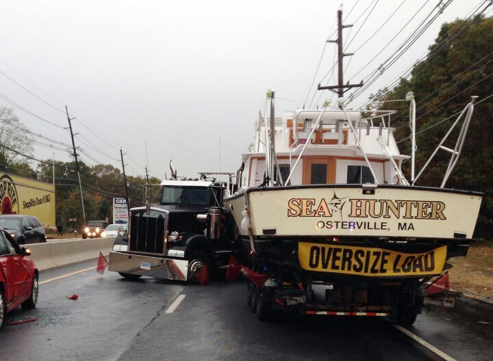 This photo provided by South Brunswick Police shows a truck carrying a boat jackknifed on a New Jersey highway on Thursday, Oct. 27, 2016 in South Brunswick, N.J. The accident lead to a fuel spill and big delays. (South Brunswick Police via AP)