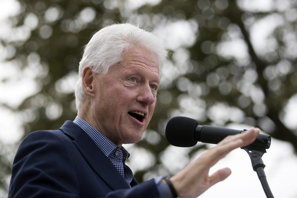 FILE - In this Oct. 14, 2016, file photo, former President Bill Clinton campaigns for his wife, Democratic presidential candidate Hillary Clinton, at Washington Park in Cincinnati. A 2011 confidential memo written by a longtime Bill Clinton aide during Hillary Clinton's State Department tenure describes overlap between the former president's business ventures and fundraising for the family's charities. The former aide also described free travel and vacations arranged for the Clintons by corporations, reinforcing ethics concerns about the Democratic presidential nominee. (AP Photo/John Minchillo, File)