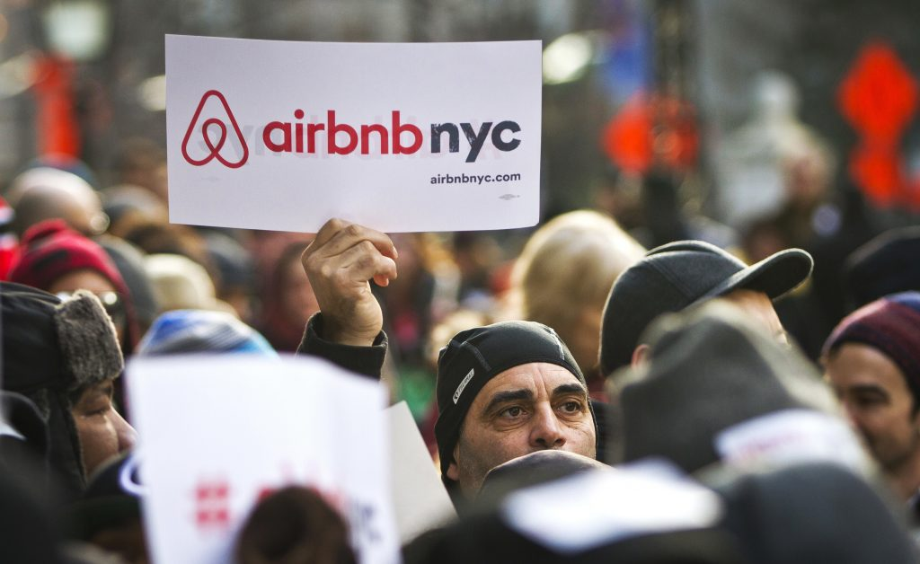 Supporters of Airbnb at a rally outside New York's City Hall in 2015. (AP Photo/Bebeto Matthews, File)