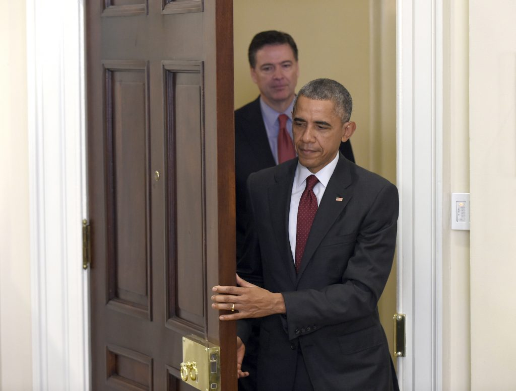 FILE - In this Nov. 25, 2015 file photo, President Barack Obama, followed by FBI Director James Comey, arrives in the Roosevelt Room of the White House in Washington to brief the public on the nation's homeland security posture heading into the holiday season, following meeting with his national security team. Comey's announcement that his bureau was reviewing new emails possibly relevant to Hillary Clinton's private email server investigation has thrust him into the public spotlight again just days before Election Day. (AP Photo/Susan Walsh, File)