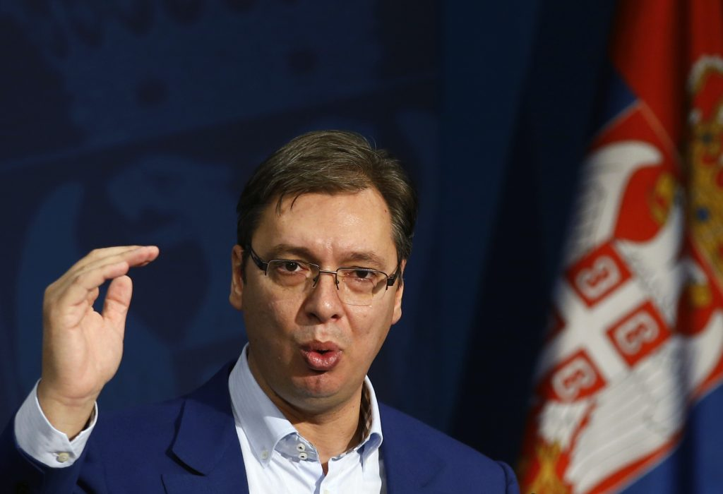 Serbian Prime Minister Aleksandar Vucic gestures during a press conference, in Belgrade, Serbia, Sunday, Oct. 30, 2016. Vucic was moved to a safe location after a large cache of weapons was found Saturday near his family house outside Belgrade, the interior minister said. (AP Photo/Darko Vojinovic)