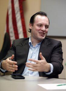 Libertarian City Council member Casey Peak chairs a meeting in Crystal, Minn. (AP Photo/Jim Mone)