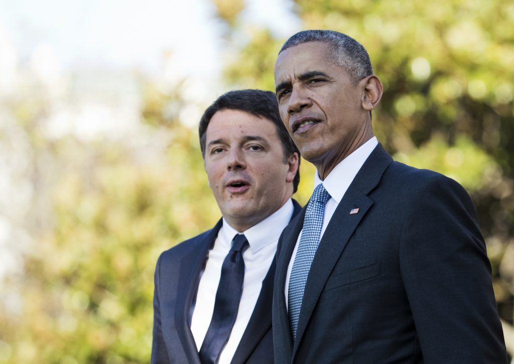 President Barack Obama and Italian Prime Minister Matteo Renzi, left, watch the United States Army Old Guard Fife and Drum Corps during a welcome ceremony on the South Lawn of the White House in Washington, Tuesday, Oct. 18, 2016. (AP Photo/Manuel Balce Ceneta)