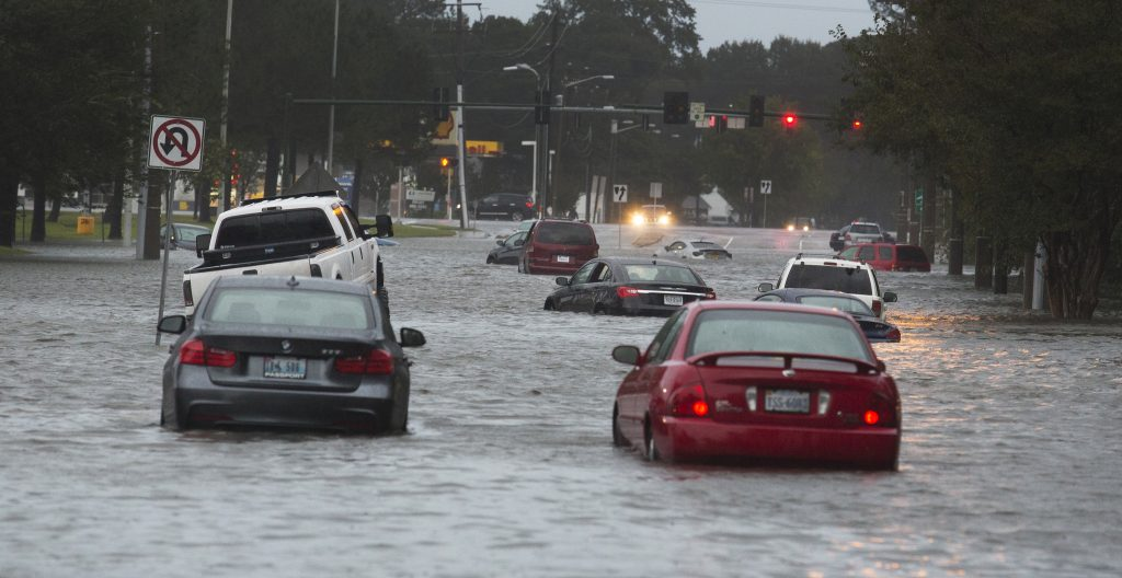 Cars are stranded in floodwater from Hurricane Matthew in Norfolk, Va.,between I-64 and Military Highway in the background on Sunday morning. (Bill Tiernan/The Daily Press via AP)