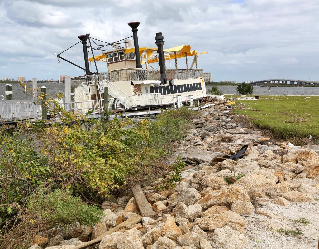 Pushed by high winds from Hurricane Matthew, a Riverboat Restaurant lays beached on the rocks, on the Halifax River in Port Orange, Fla., on Monday. (Joe Burbank/Orlando Sentinel via AP)