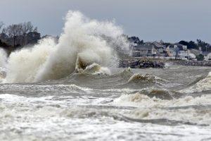 Waves crash ashore in Hampton, Va. (Jonathon Gruenke/The Daily Press via AP)
