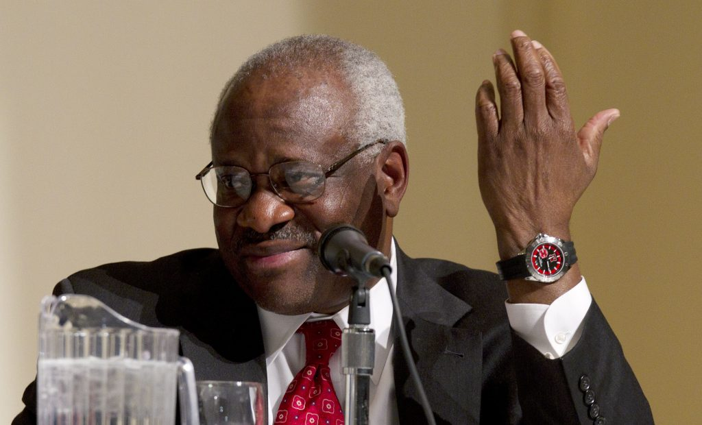 Supreme Court Justice Clarence Thomas participating in a panel discussion at College of the Holy Cross in Worcester, Mass., in 2012. (AP Photo/Michael Dwyer)