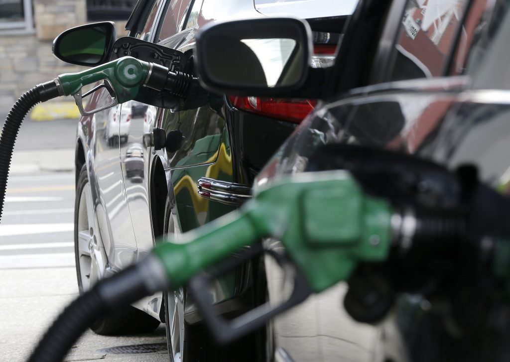 Nozzles pump gas into vehicles at a BP gas station, in Hoboken, N.J. New Jersey. (AP Photo/Julio Cortez)