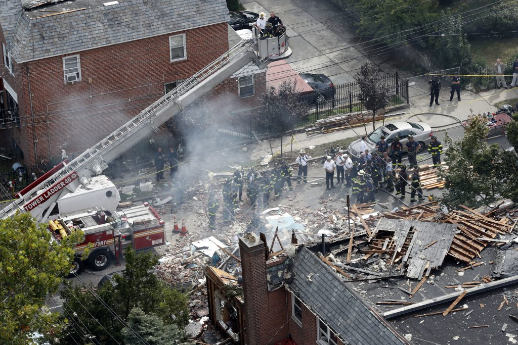 Emergency service personnel work at the scene of the Bronx house explosion on Sept. 27. (AP Photo/Mary Altaffer)