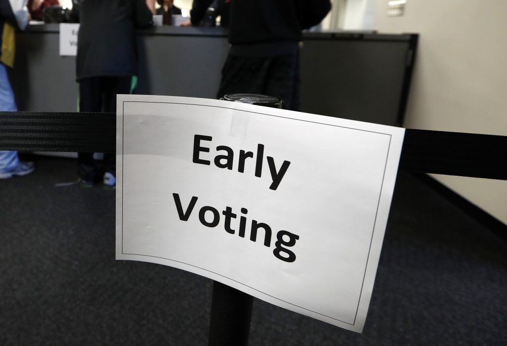 An early voting sign on the first day of early voting in Des Moines, Iowa, on Sept. 29. (AP Photo/Charlie Neibergall)