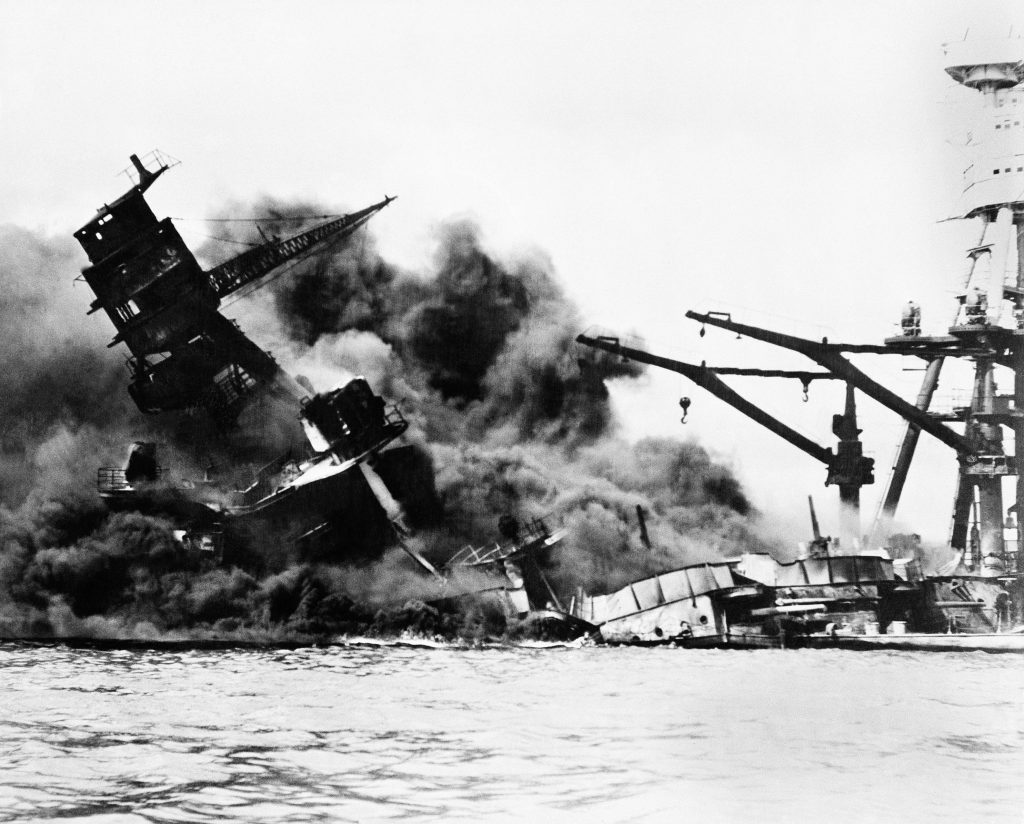 The battleship USS Arizona topples over into the sea during Japanese surprise attack on Pearl Harbor, Hawaii, December 7, 1941. The ship sank with more than 80 percent of its 1,500-man crew. (AP Photo)
