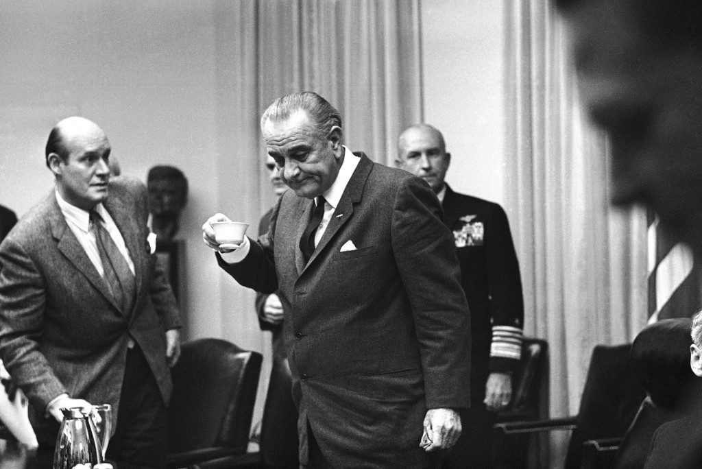 AP Photo President Lyndon Johnson in Washington, following a meeting with military advisers before announcing a complete halt to all bombardment of North Vietnam, Oct. 31, 1968. With him at the White House Cabinet meeting are Undersecretary of State Nicholas Katzenbach (L), Adm. Thomas Moorer (R), chief of naval operation; and Army Chief of Staff William Westmoreland, partially visible behind the president.