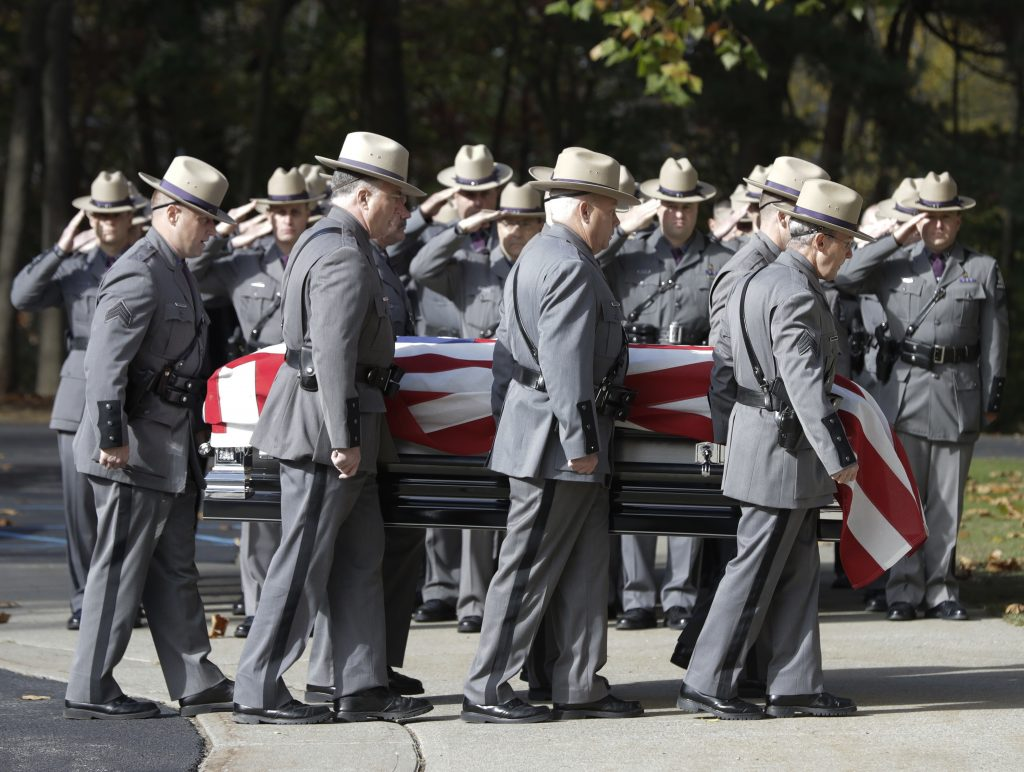 The casket bearing New York State Police Trooper Timothy Pratt is carried to a church  in South Glens Falls, N.Y., on Monday. (AP Photo/Mike Groll)