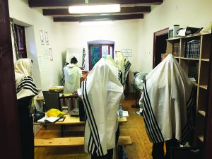 Davening in the room where Harav Shaya'le would receive visitors and give brachos.