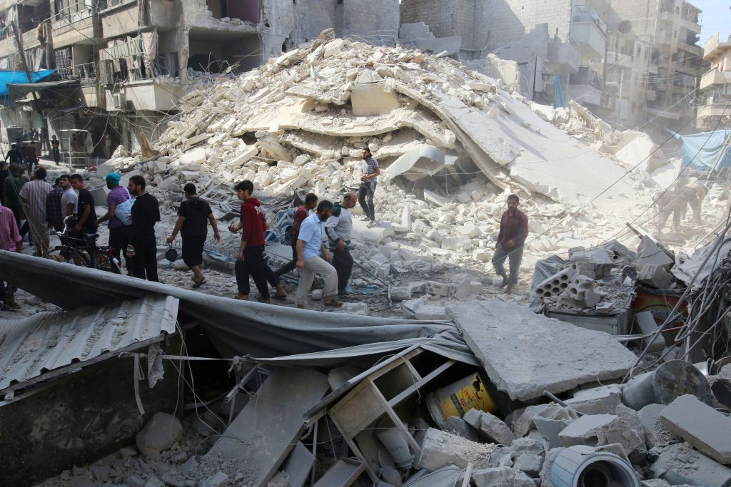 People inspect the damage at a market hit by airstrikes in Aleppo's rebel held al-Fardous district, Syria October 12, 2016. REUTERS/Abdalrhman Ismail