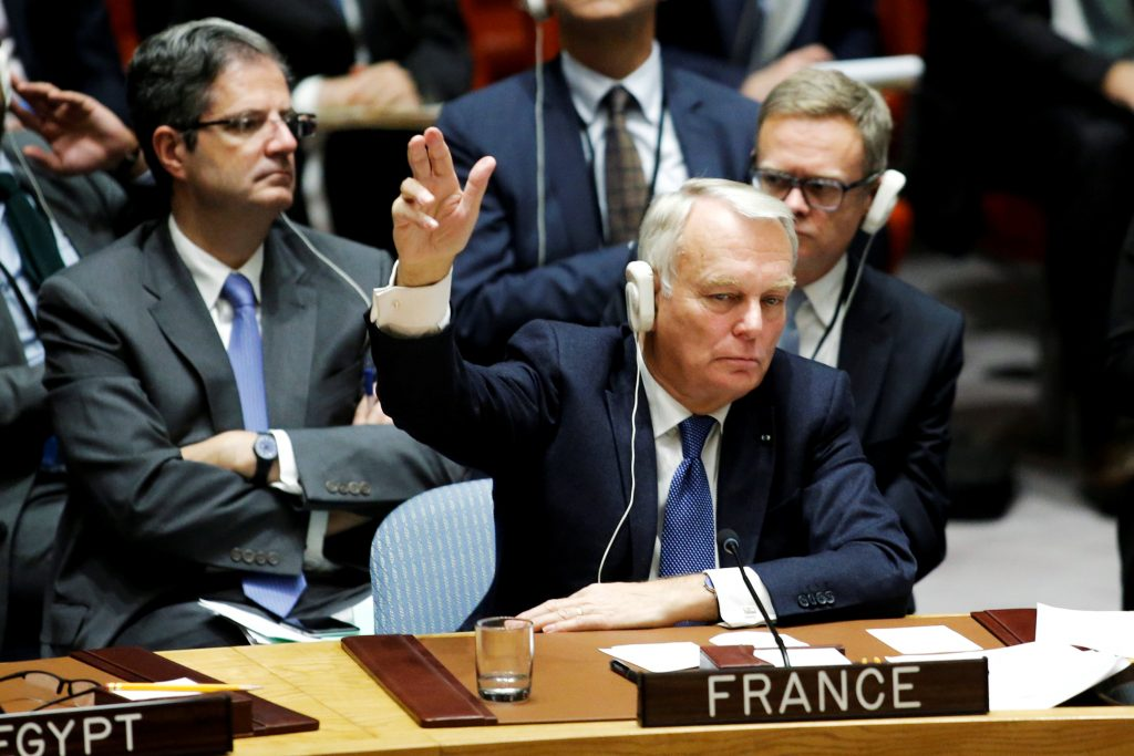 France's Foreign Minister Jean-Marc Ayrault votes in favor of a draft resolution that demands an immediate end to air strikes and military flights over Syria's Aleppo city, during a meeting of Members of Security Council at the U.N. Headquarters in New York, U.S., October 8, 2016. REUTERS/Eduardo Munoz