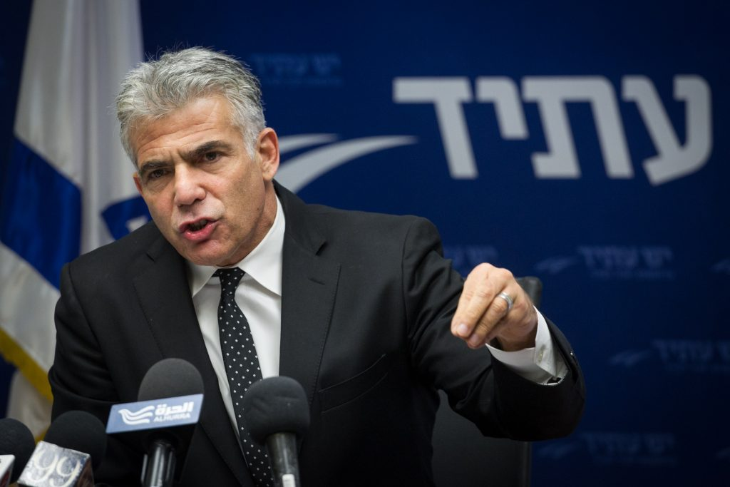 Yesh Atid leader Yair Lapid giving a speech to party members. (Miriam Alster/Flash90)