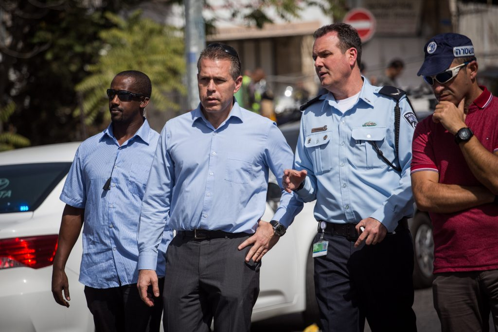 Minister of Interior Security Gilad Erdan at the scene of the terror attack in Yerushalayim on Sunday. (Hadas Parush/Flash90)