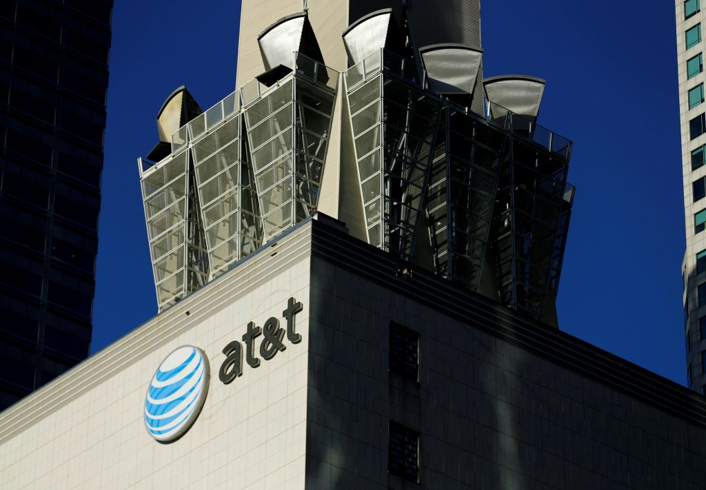 An AT&T logo and communication equipment is shown on a building in downtown Los Angeles, California October 29, 2014.    REUTERS/Mike Blake/File Photo