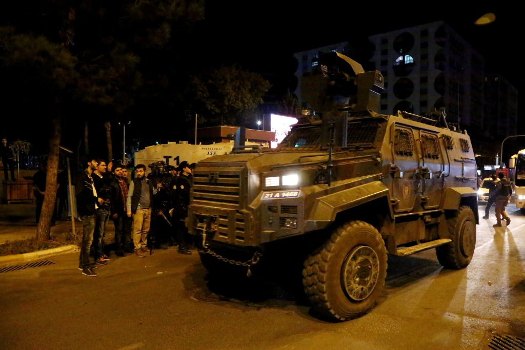 An armored police vehicle is parked in front of the Metropolitan Municipality headquarters in the Kurdish-dominated southeastern city of Diyarbakir, Turkey, October 25, 2016. Picture taken October 25, 2016. REUTERS/Sertac Kayar