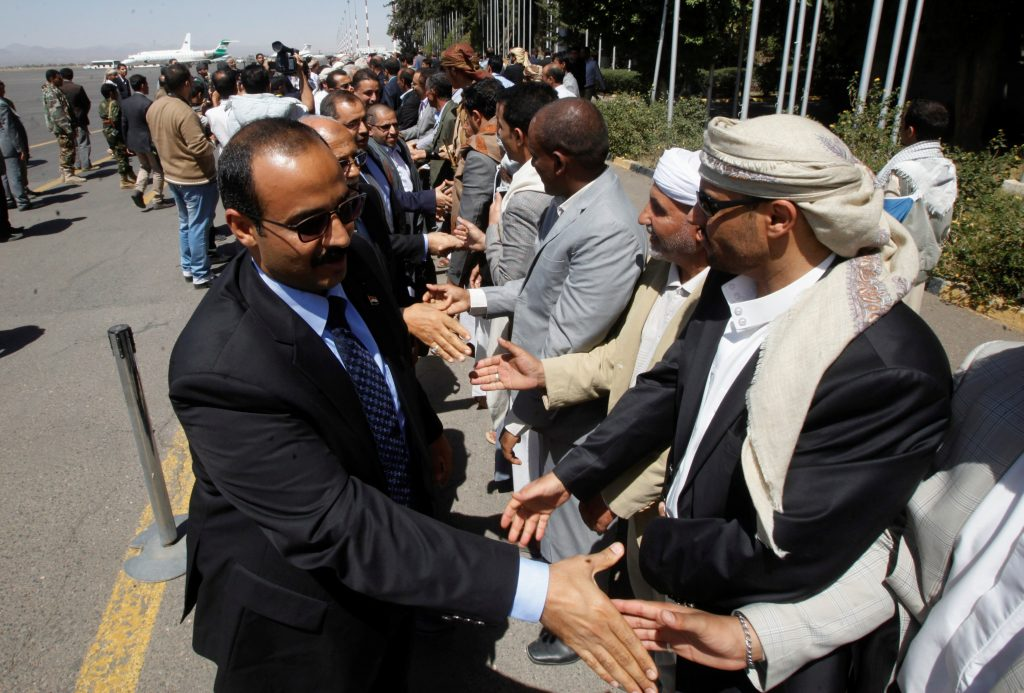 Members of the Houthi negotiating team who were stranded in Oman, are welcomed upon the team's arrival at the airport in Sanaa, Yemen, October 15, 2016. The team has been in Oman since the collapse of peace talks after Saudi authorities in control of Yemen's airspace refused to grant the team access to Sanaa. REUTERS/Mohamed al-Sayaghi