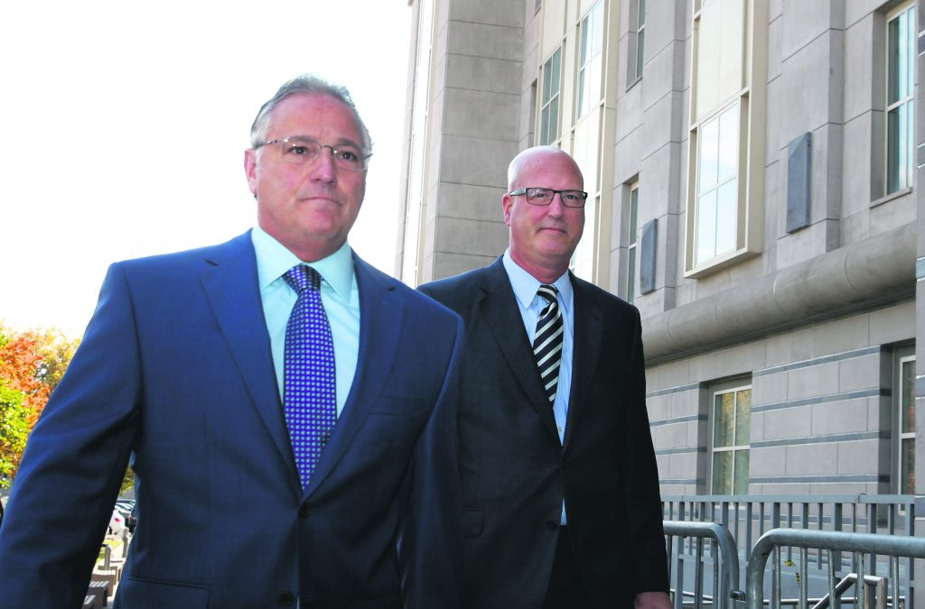 Michael Drewniak, right, long time press spokesman for Gov. Chris Christie, and attorney Anthony Iacullo, left, arrive at Martin Luther King Jr. Federal Courthouse for a hearing, Wednesday, Oct. 19, 2016, in Newark, N.J. Three years after gridlock paralyzed a New Jersey town next to the George Washington Bridge for days, two former allies of New Jersey Gov. Chris Christie, Bill Baroni, Christie's former top appointee at the Port Authority of New York and New Jersey,  and Chris Christie's former Deputy Chief of Staff Bridget Anne Kelly, are being tried on charges of politically motivated lane closures of the George Washington Bridge in 2013. (AP Photo/Mel Evans)