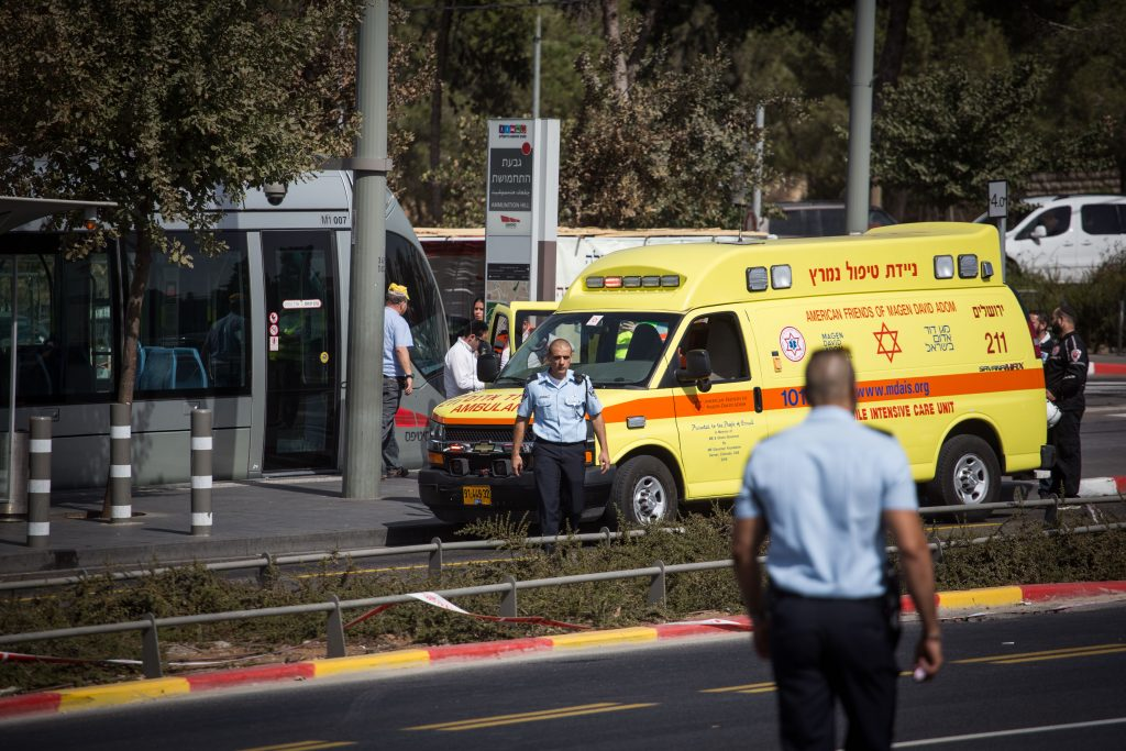 Police at a scene of a terror attack in front of the National Police Headquarters in Yerushalayim. (Hadas Parush/Flash90)