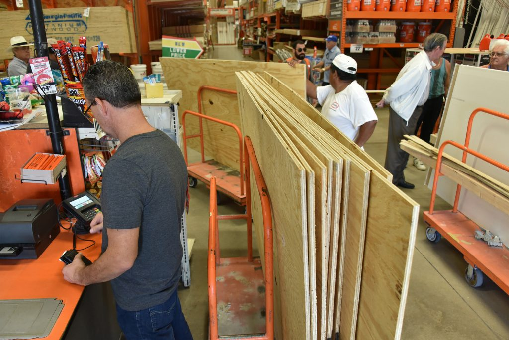 Customers at a Miami Home Depot stock up on plywood Tuesday.(Bloomberg photo by Mark Elias)