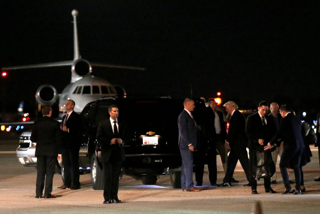President-elect Donald Trump walks to his car from his plane after landing in West Palm Beach, Florida, to spend the Thanksgiving holiday with family at the Mar-a-Lago estate in Palm Beach, Florida. (Mike Segar/Reuters)