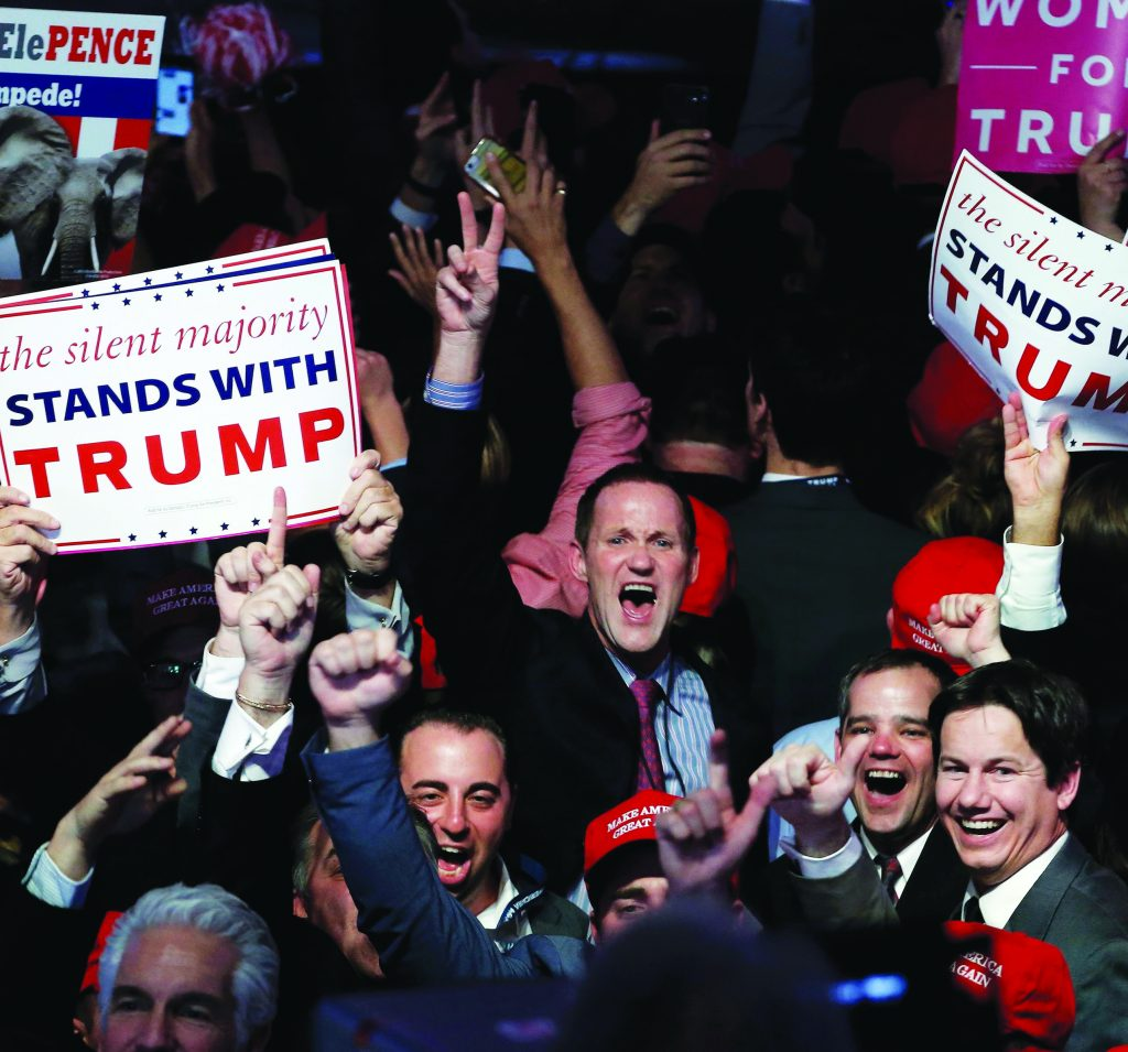 Supporters celebrate as returns come in for Republican presidential nominee Donald Trump during an election night rally in New York, on November 9. (Mike Segar/Reuters)