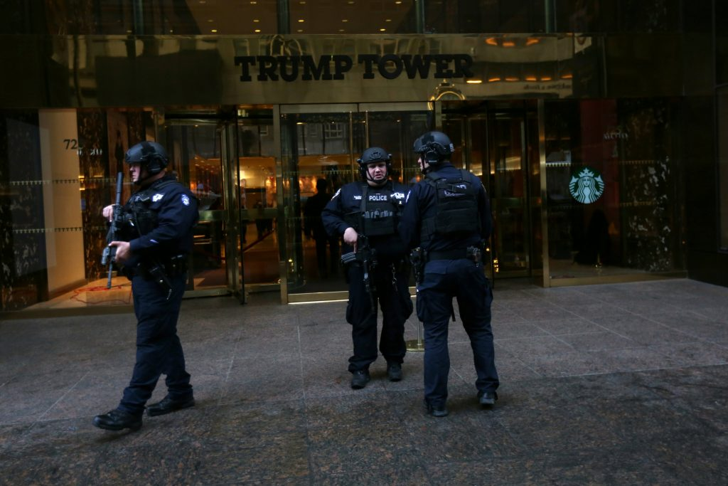 New York Police officers stand outside the main door at Trump Tower after the election selected Republican president-elect Donald Trump in New York, November 9. (Carlo Allegri/Reuters)