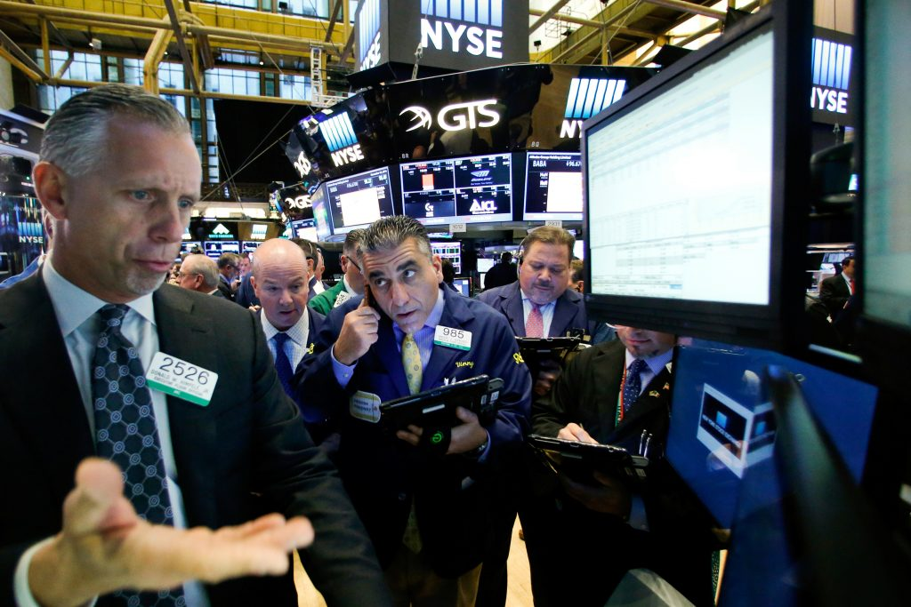 Traders work on the floor of the New York Stock Exchange on Monday. (Reuters/Brendan McDermid)