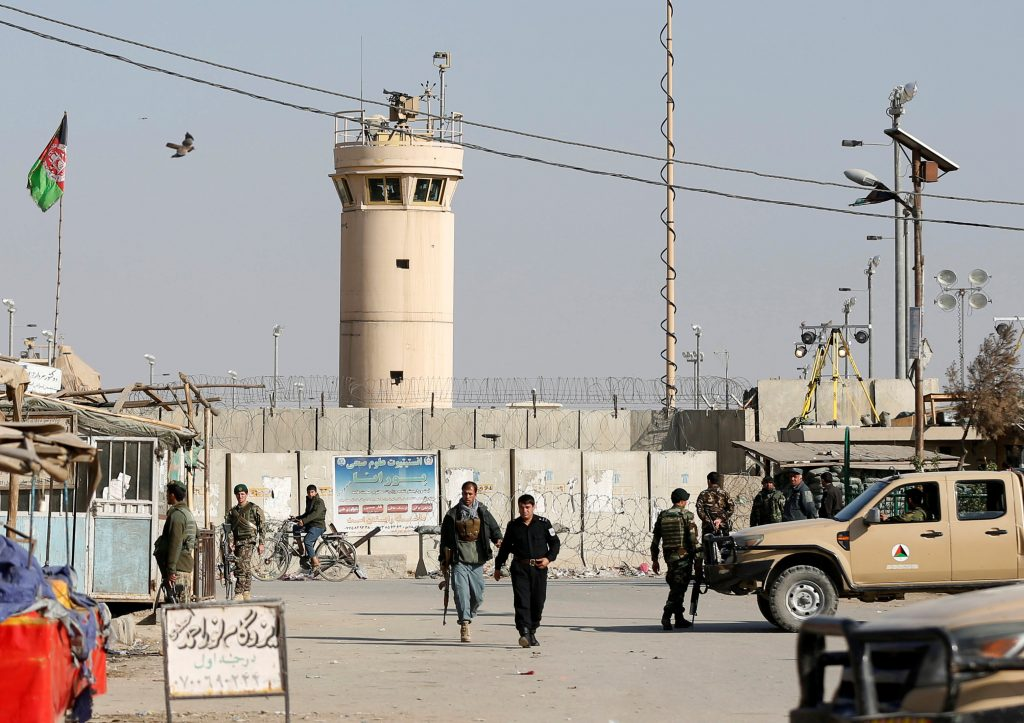 Afghan National Army (ANA) soldiers and police keep watch outside the Bagram Airfield entrance gate, after an explosion at the NATO air base, north of Kabul, Afghanistan. (Omar Sobhani/Reuters)