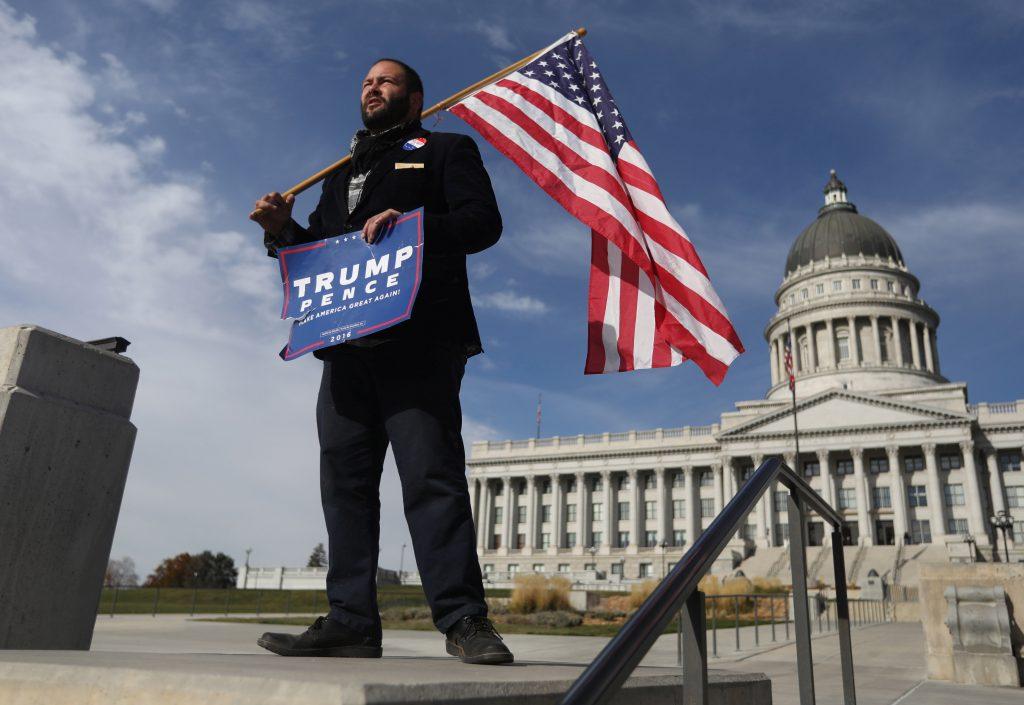 Donald Trump supporter Kern Carlos Huerta waits at the Utah State Capitol building for demonstrators protesting the election of Republican Donald Trump as President of the United States in Salt Lake City, Utah. (Jim Urquhart/Reuters)