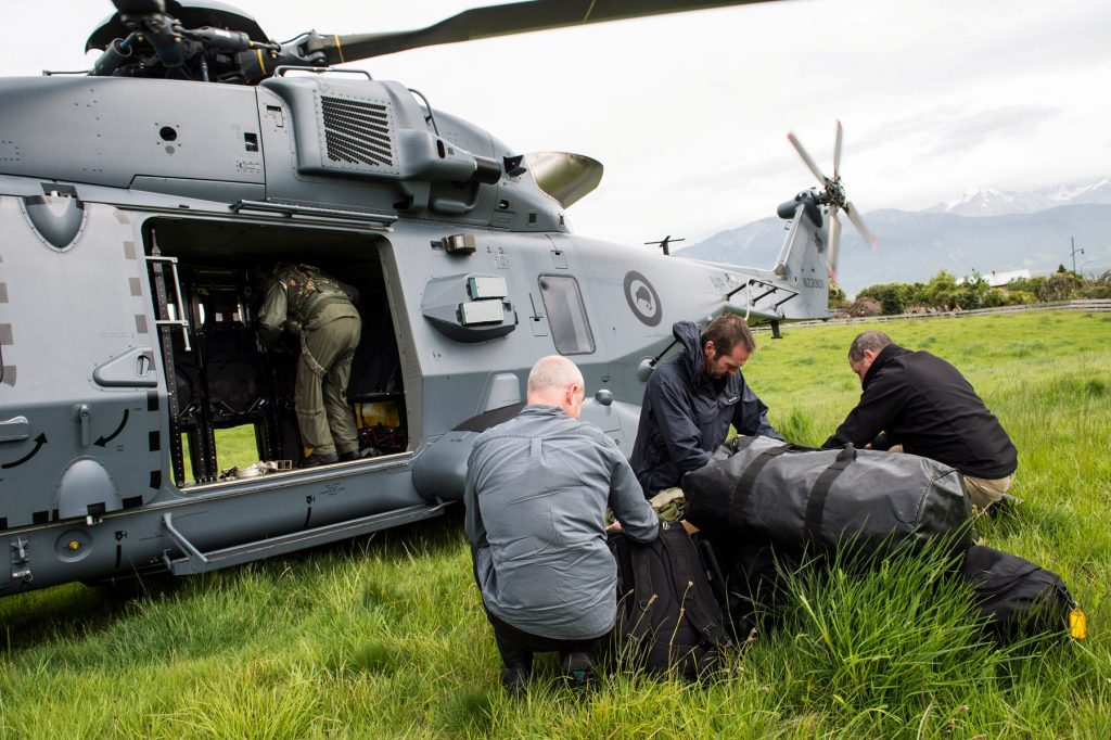 A Royal New Zealand Air Force NH90 helicopter delivers government officials and police to assess earthquake damage in Kaihoura on the upper east coast of New Zealand's South Island, November 14. (Sgt Sam Shepherd/Courtesy of Royal New Zealand Defence Force/Handout via Reuters)