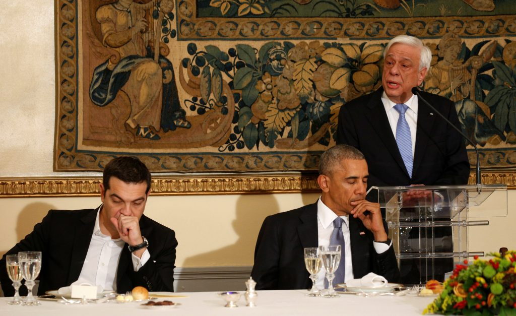 President BarackObamaand Greek Prime Minister Alexis Tsipras listen as Greek President Prokopis Pavlopoulos speaks during a state dinner inObama's honor at the Presidential Mansion in Athens, Greece, Tuesday. (Kevin Lamarque/Reuters)