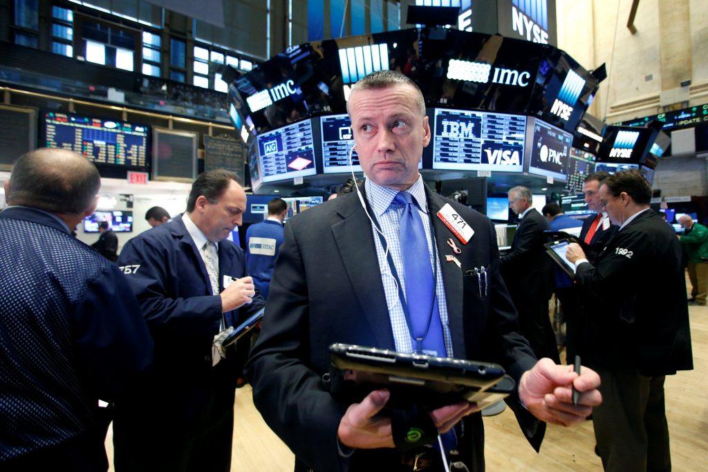Traders  on the floor of the New York Stock Exchange on Wednesday. (Reuters/Brendan McDermid)