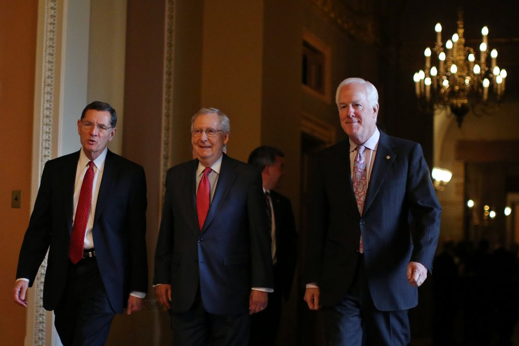 Republican leaders (L-R) Senator John Barrasso (R-WY), Majority Leader Mitch McConnell (R-KY) and Senator John Cornyn (R-TX) leave after attending the Senate Republican leadership elections at the Capitol on Wednesday. (Reuters/Carlos Barria)