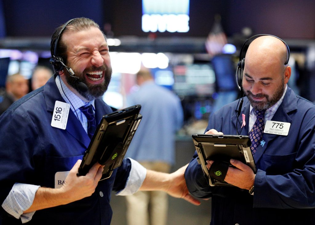Traders work on the floor of the New York Stock Exchange on Friday. (Reuters/Brendan McDermid)