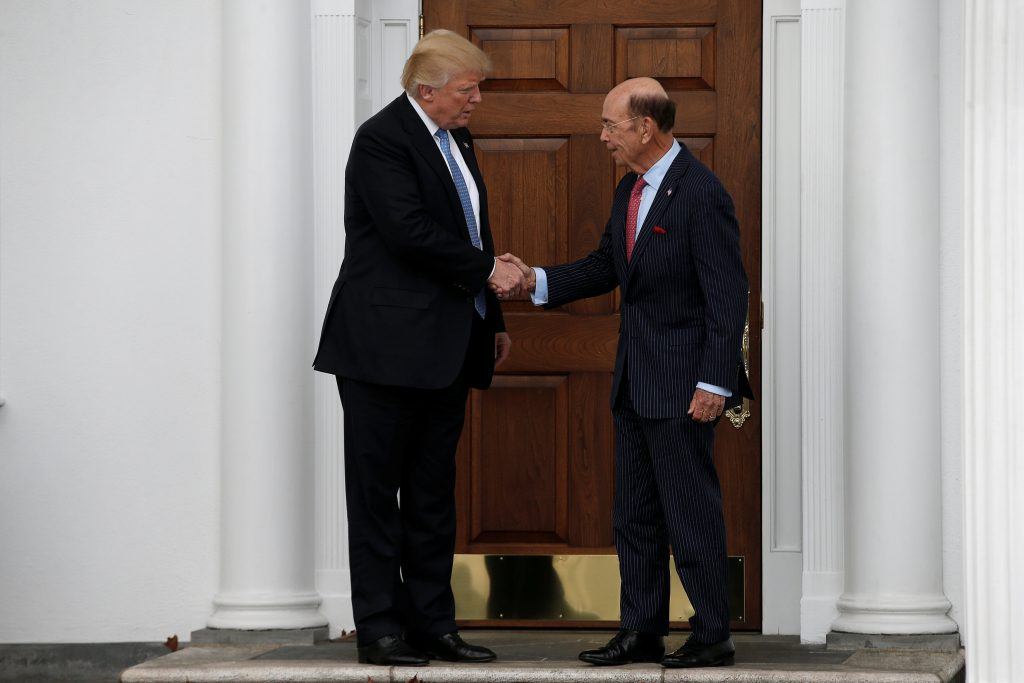 U.S. President-elect Donald Trump shakes hands with Wilbur Ross after their meeting at Trump National Golf Club in Bedminster, New Jersey. (Mike Segar/Reuters)