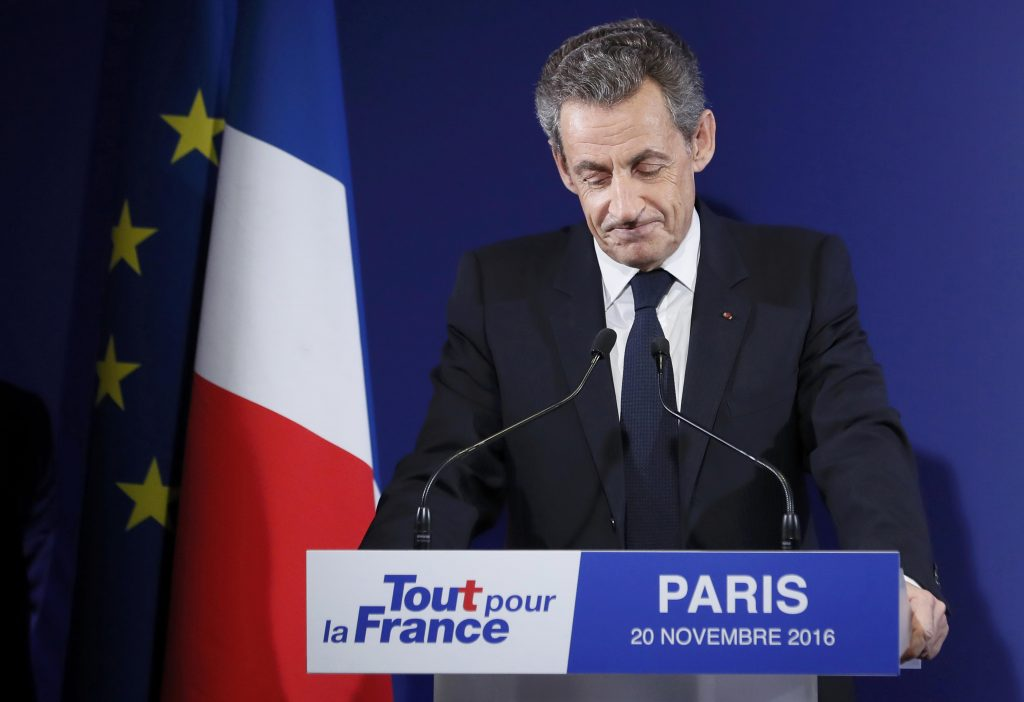 Nicolas Sarkozy, former French president and candidate for the French conservative presidential primary, reacts after the results in the first round of the French center-right presidential primary election at his headquarters in Paris, France. (Ian Langsdon/Reuters/Pool)