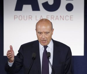 French politician Alain Juppe, current mayor of Bordeaux, and member of the conservative Les Republicains political party, reacts after partial results in the first round of the French center-right presidential primary election vote at his campaign headquarters in Paris, France. (Charles Platiau/Reuters)