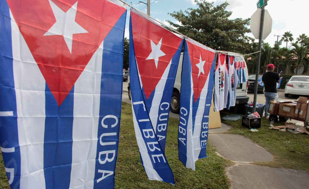 A man sells Cuban flags after the announcement of the death of Cuban revolutionary leader Fidel Castro in the Little Havana district of Miami, Florida.(Javier Galeano/Reuters)