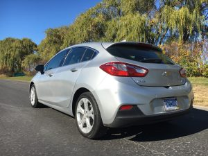 The rear wheels are tucked close to the tail and the integrated spoiler at the top of the hatch gives it an edge. The Premier trim level comes upgraded with unremarkable 18-inch wheels. (Robert Duffer/Chicago Tribune/TNS)