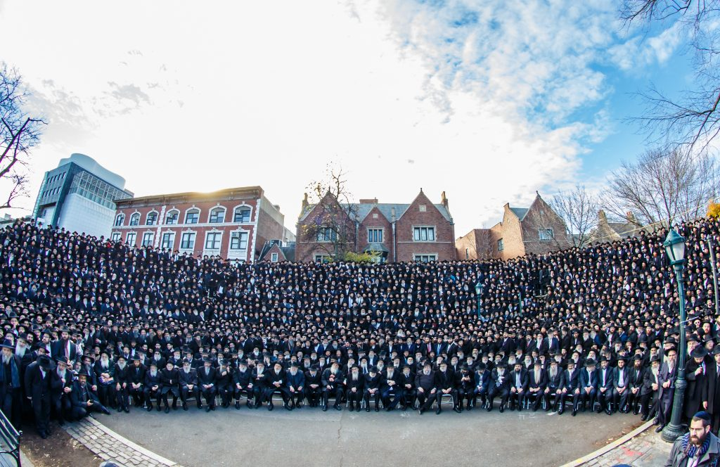 """Thousands Shluchim pose for a group photo in front of Chabad-Lubavitch world headquarters in Brooklyn New York, Sunday, Nov. 27. They are among 4,550 rabbis from around the world who are in New York for the International Conference of Chabad-Lubavitch Emissaries, an annual event aimed at reviving Jewish awareness and practice around the world. This year's conference carries an added significance as the North American Jewish community marks 75 years since the Lubavitcher Rebbe zy""""a, arrived on U.S. shores from war-torn Europe in 1941. (Eliyahu Parypa/Chabad.org)"""