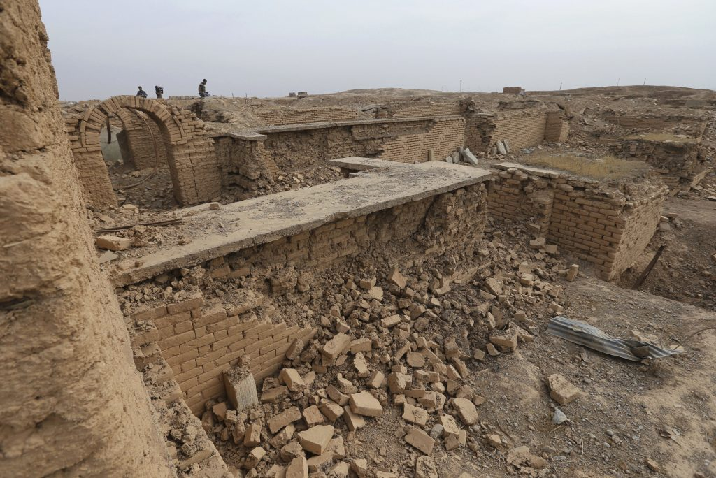 Journalists look around at the ancient site of Nimrud, which was destroyed by the Islamic State, some 19 miles southeast of Mosul, Iraq, Wednesday.(AP Photo/Hussein Malla)