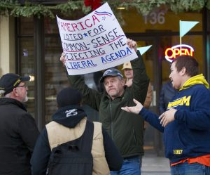 Trump supporters Mark Bowman (C) and Mike Bush (R) argue with anti-Trump protesters at Rosa Parks Circle in Grand Rapids, Mich., on Thursday. (Cory Morse/The Grand Rapids Press via AP)